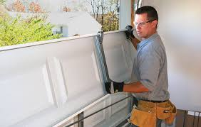 Handyman doing some garage door repairs